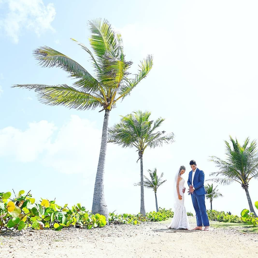 Pretty Klip Point at Sapphire Beach Resort offers dramatic tropical palms to lead you down the aisle 🌴 photo by @blueglassphotograph