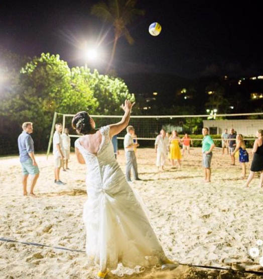 Wedding Party playing sand volleyball at Bolongo Bay.