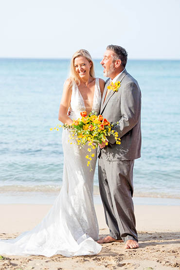 Marriage vow renewals barefoot on St Thomas USVI beach.