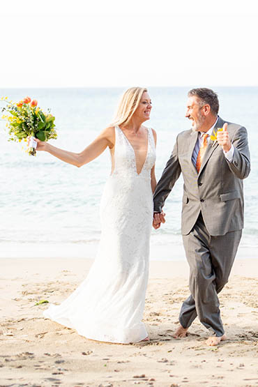 Happily wedded couple renewing their vows on a beach in St Thomas.