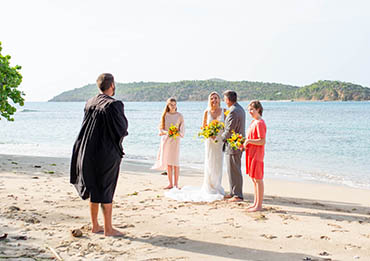 Vow renewal ceremony with kids on a tropical beach in St. Thomas US Virgin Islands.