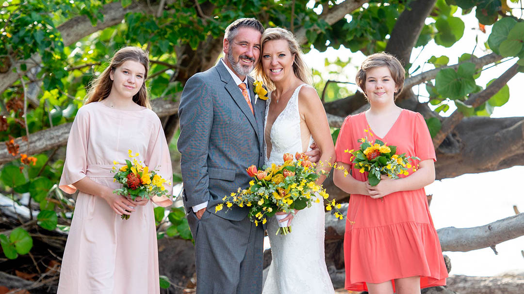 Family together on a beautiful beach for vow renewal ceremony in USVI.